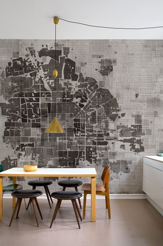 A lovely room. The gold lampshade pops against the black and white map and draws your eye to its centre before you take in all of the map and then the rest of the room. The black stools and light table help to actor the map in the room, so everything is brought together.