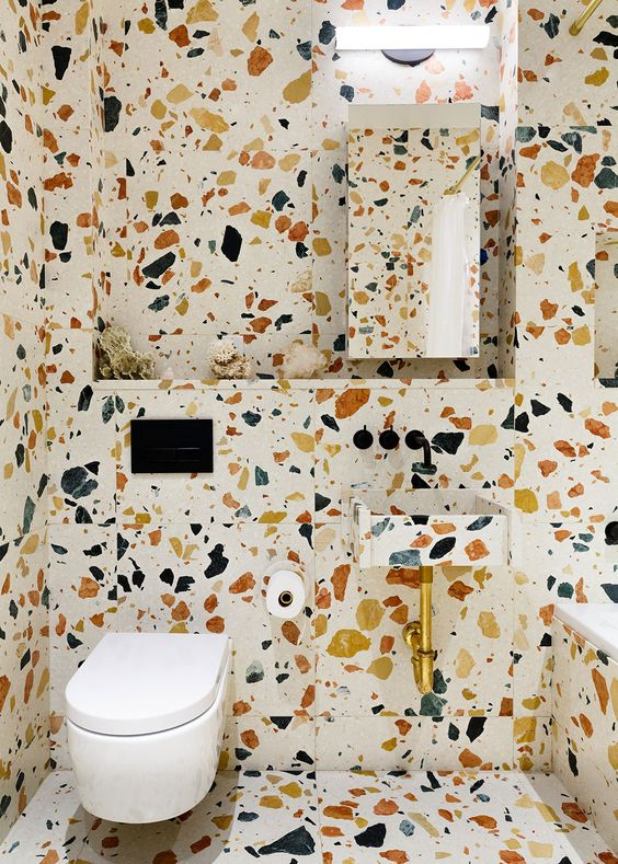 You may have trouble finding the sink to wash your hands, but crazy tiling is definitely not dull.