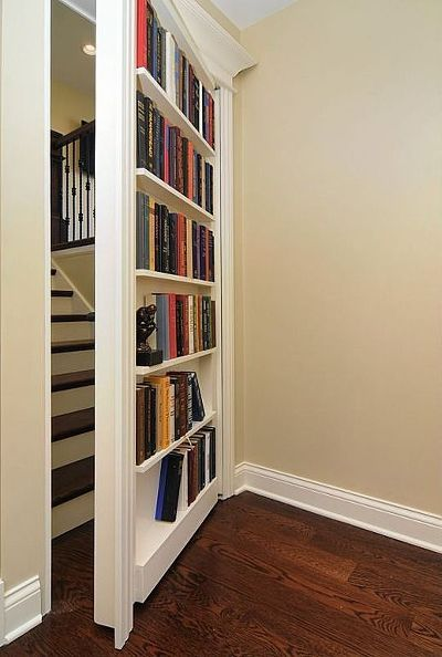 Creating what looks like a secret door to a loft conversion or another part of the house would bring an element of mystery (and extra storage space for books too!)