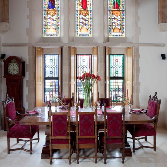 The choice of furniture for this dining room blend well with this former church.