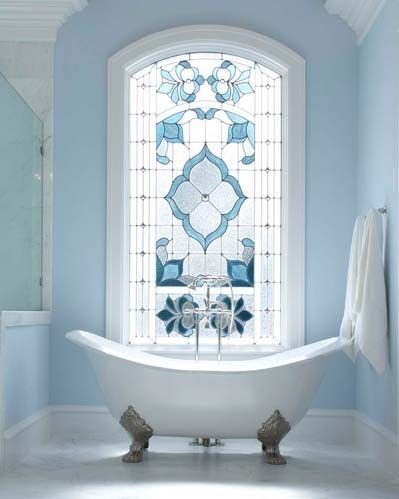A bathroom is the perfect room for coloured glass windows. Not only do they offer privacy, but they can create a relaxing and elegant room.