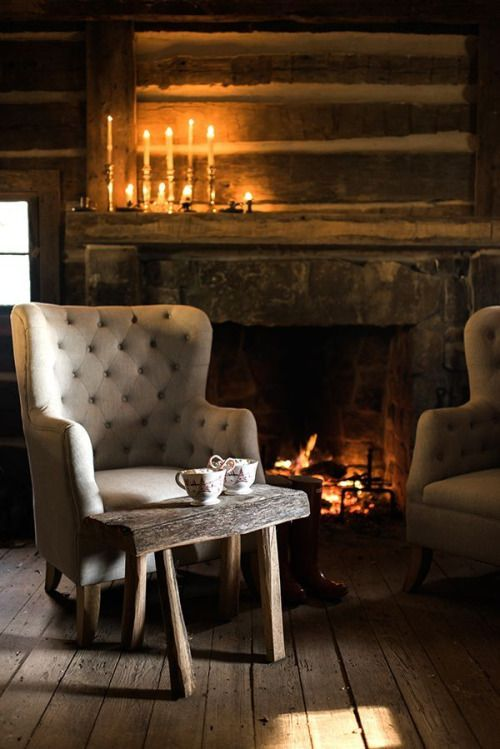 Two armchairs in front of the fire, in a corner of the room lit only by candles, encourages warm, relaxed conversations in the evening.