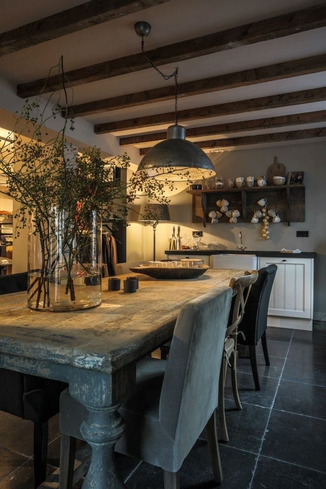 A low pendant lamp over the dining room table creates a soft light over this social space as the evening sets in.