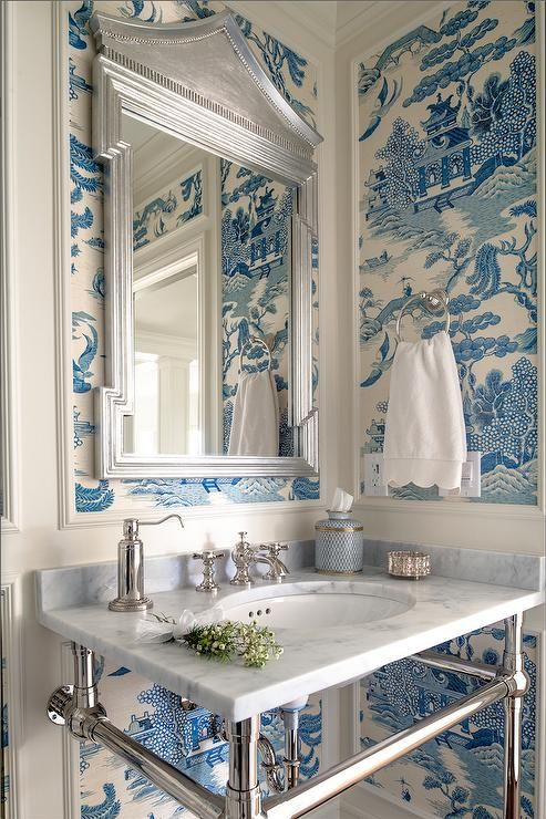 Get the oriental look in your own home by choosing a bold chinoiserie wallpaper. The timeless blue and white colour scheme here looks elegant with the marble sink and silvered shiny accessories.