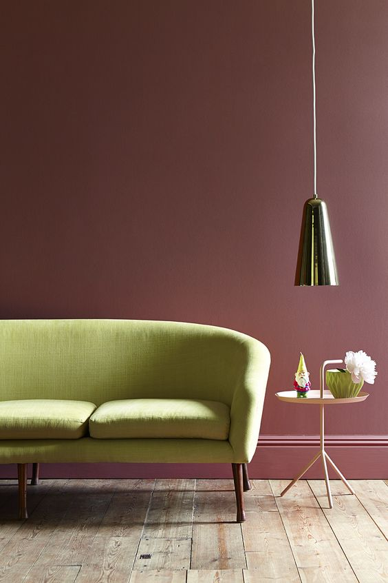 This 'Ashes of Roses' Victorian heritage paint from Little Greene brings warmth and looks fabulous behind this citron sofa. A brilliant colour scheme to bring some Victorian flair to your home.