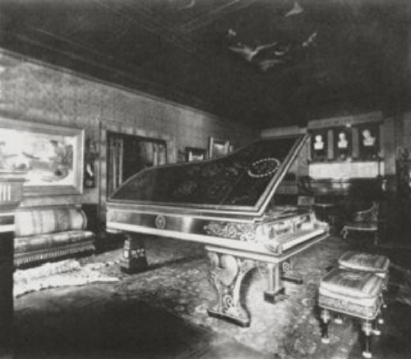 This Greek-style music room was commissioned in 1884 by American art collector Henry Gurdon Marquand for his New York house. The ceiling was decorated with paintings of the Greek muses and Greek and Roman vases and statues were displayed around the room.The suite of furniture was richly embellished with Greek motifs and was much admired in London before being shipped to America. The room also held one of the largest pianos in New York City.