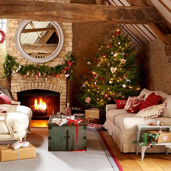 A celebration of warmth and colour! Multi-textured cushions, flowing ribbons, hanging decorations. Pine cones on the tree, along with a host of handmade ornaments in soft fabrics, as well as mirrored glass, shimmering metallics. An open fire you can prod and poke or roast chestnuts in... Immerse yourself in festive brights of red, white, gold, brass and copper.    Source: housetohome.co.uk