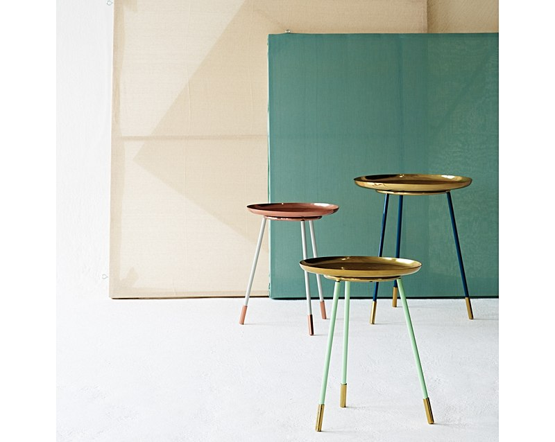 These side tables will brighten up any home!I love the fact that the legs come in three versatile shades and the metallic top will sparkle and shine, bringing a touch of opulence to a relaxed living space.  Source:  Oliver Bonas