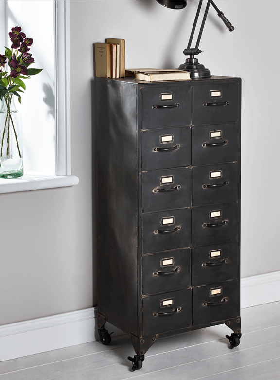 You can imagine stumbling upon this beauty in a vintage store. It looks like a snapshot of history from another era. Practical too with 12 drawers and being on wheels means you can move it into the perfect place.  Source:  Cox & Cox