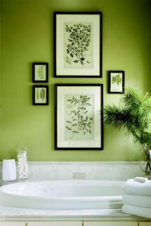 The bathroom is one of the best (and safest!) places to try out this colour. Traditionally a bathroom suite is white and it goes so well with Greenery. What's made a difference in this bathroom is the use of white marble as a splash back, which provides texture and interest to the white. And the way the owner has added the black framed plant pictures. They break up the colour, but at the same time re-inforce it and what it represents. Very effective. I love too the plant peeping in at the side.    Picture: due-home.com