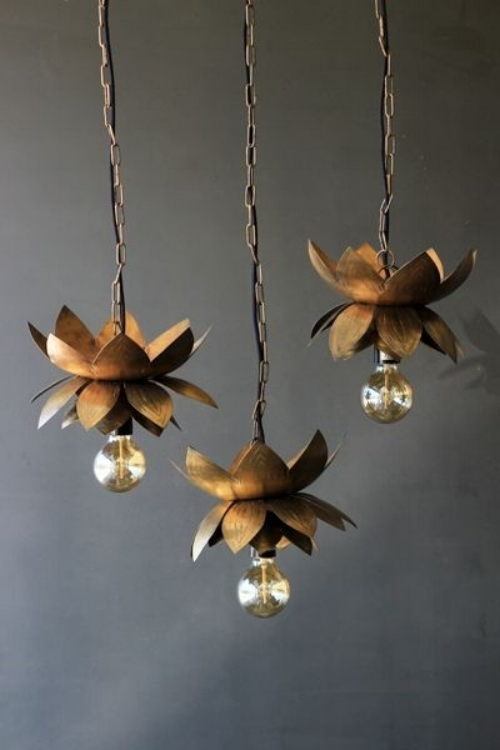 2) Brass Flower Ceiling Light   This piece of gorgeousness will definitely create a warm glow in your home. With its twinkling light you'll enjoy sitting cozy inside on cold, dark evenings.