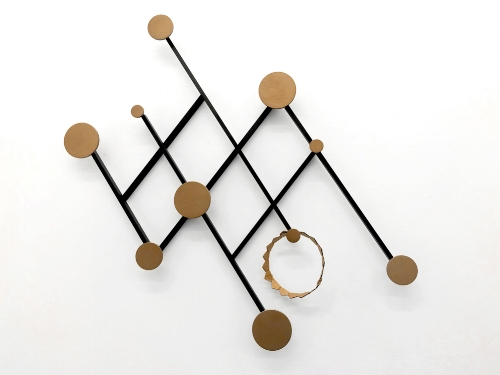 5    ) Memoir Wall Hanger     Not just any coat rack, this Art Deco inspired wall hanger looks more like a work of art. But it's practical too and the knobs of different sizes mean it'll be easy to find a place for all your outdoor wear.