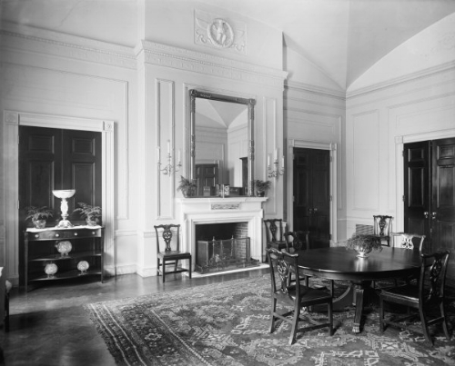 Beautifully decorated using a large oriental rug and dark furniture. The tall mirror shows off the room's high ceiling.   Photo: whitehousemuseum.org