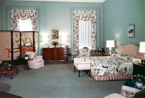 The master bedroom in 1958, back to being a bedroom and decorated by Mamie Eisenhower. Her fondness for this shade of pink sparked a national trend for pink clothing, homewares and bathrooms. It was also Mamie Eisenhower who was the first person to initiate Halloween decorations to be put up in the White House.   Photo: whitehousemuseum.org