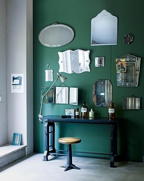 The colour of this wall is lovely and provides a wonderful backdrop to this group of mirrors. They're all different but they're rim-less style brings this collection together.   Image: remodelista.com