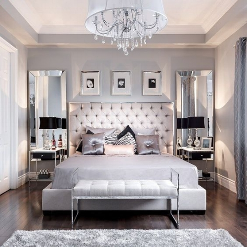 Long mirrors and the grey, white and black colour scheme create a sense of opulence and elegance. The mirrors help the walls recede, they remove any feeling of barrier and seem more like widows, so the bed takes all the focus.  Image : decoholic.org