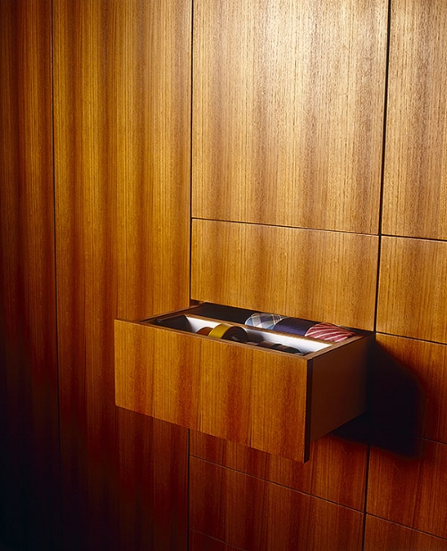 Or conceal your storage in what looks like a wall. It will get rid of your clutter and you could have this beautiful wood to look at each day.   Image: design hunter.co.uk