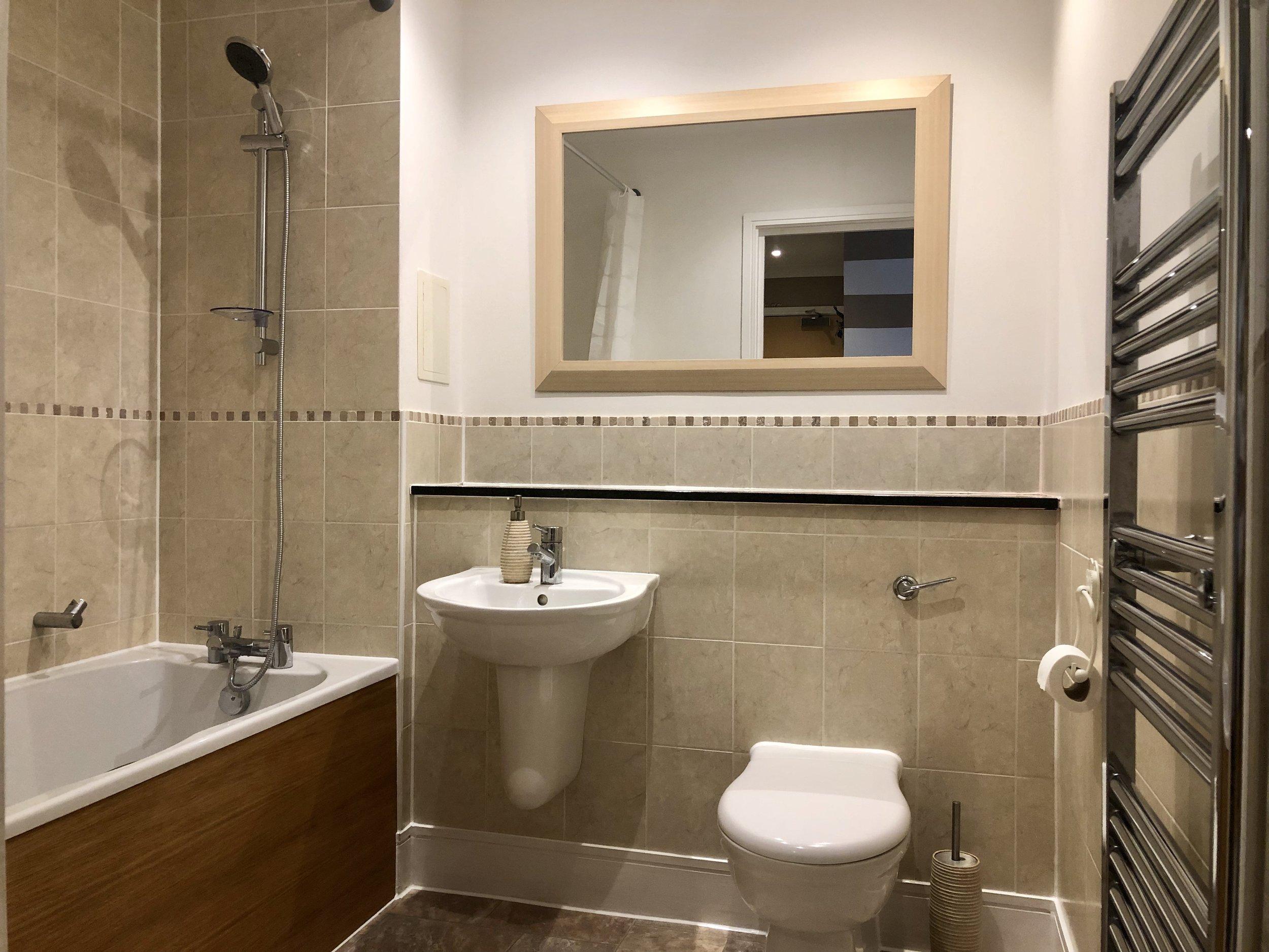 502AS Bathroom with shower over bath.jpg