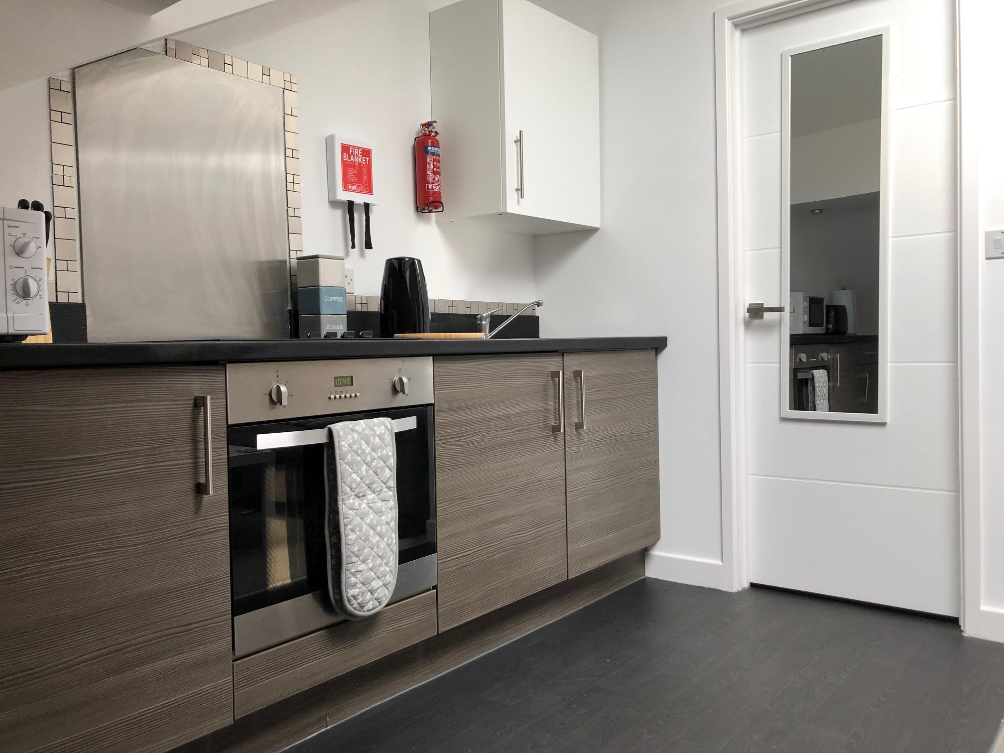 72SEH Kitchen area and door to shower room.jpg