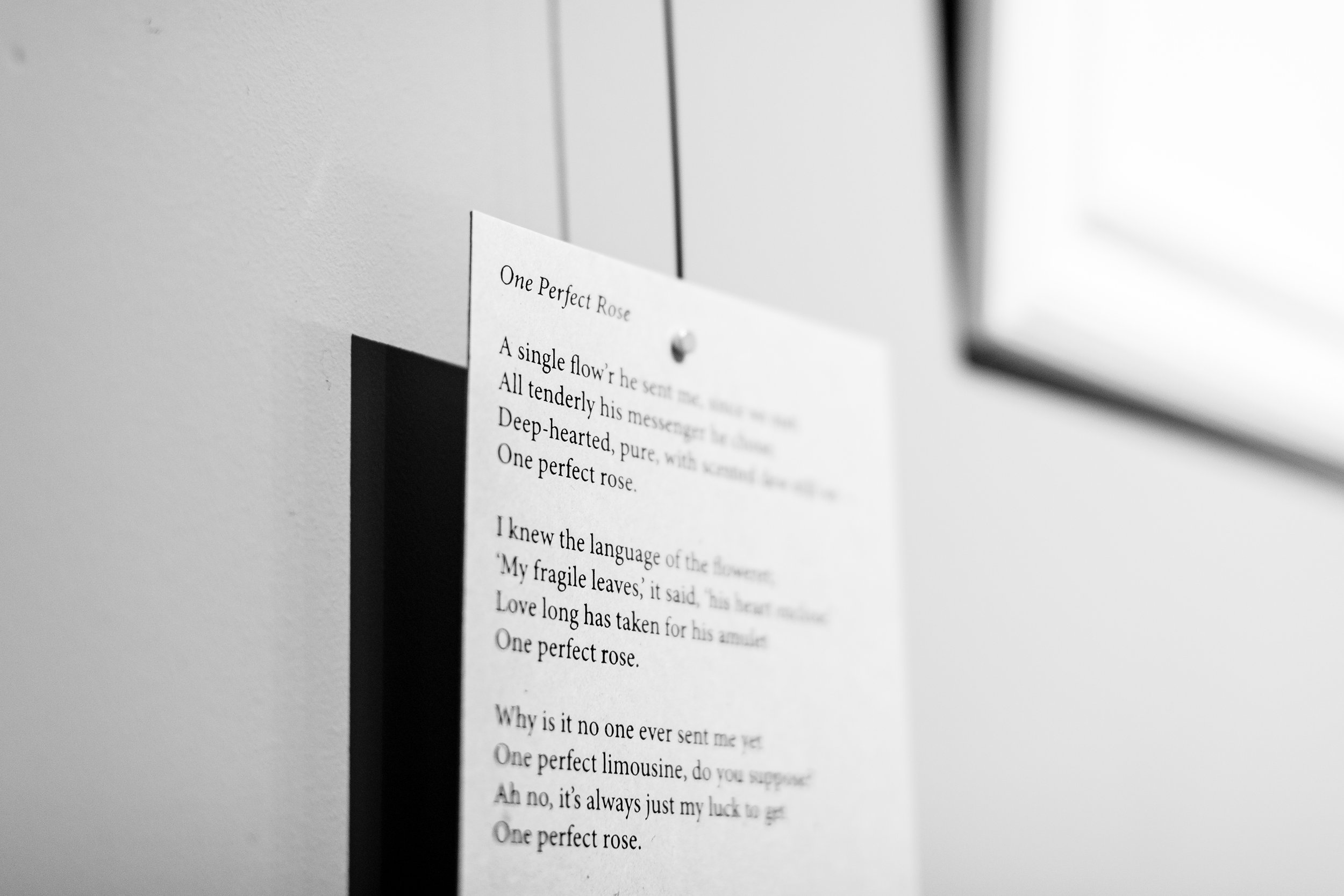 I used poetry cards on the wall hung from metal lines.