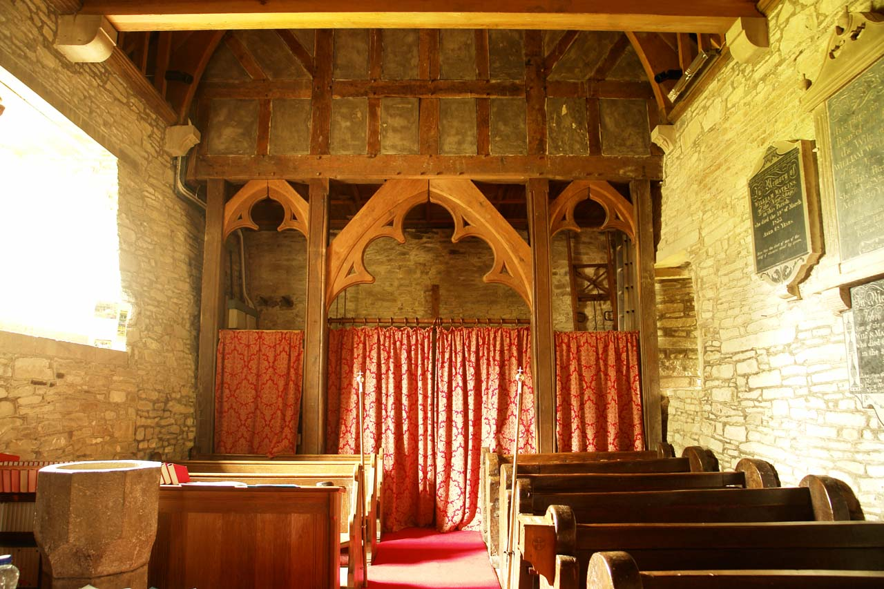 The vestry at back with font in the foreground on the left