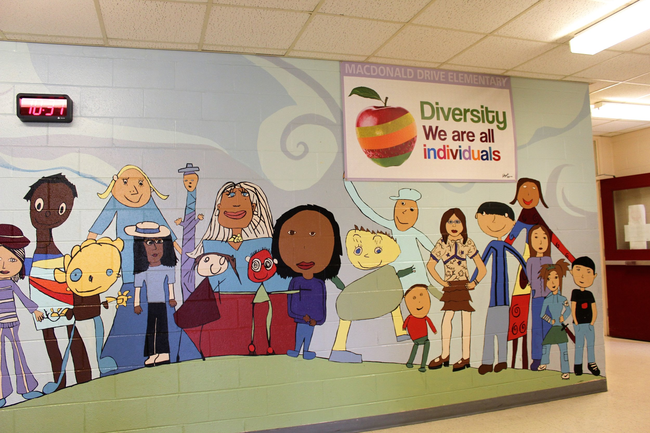 Upon entering our school, all teachers, students, parents, and visitors are immersed in a multicultural atmosphere. The colourful mural of children (painted by previous students) on the wall, along with the poster above it, communicate our appreciation of the diverse cultures in our student population and the world, in general. Discussion generated about the importance and meaning of the words and images was very rich, enlightening, and for many, reaffirming of their individual place within the whole of the school-we all belong. Now every time we walk by, children not only look but realize the meaning and importance of what they are seeing.  This activity connects to the foundation of global citizenship as the children are able to see themselves in the images of the mural. They recognize the diversity amongst themselves and were able to connect the variety of student cultures in our one school to the different colours and textures of the peels on the one apple. They also made links to the world, in general. They understand that all of the children are interconnected within our school just like our world is made up of all kinds of cultures and people, just like us. We are all citizens of the school and world, and our diversity makes us special.
