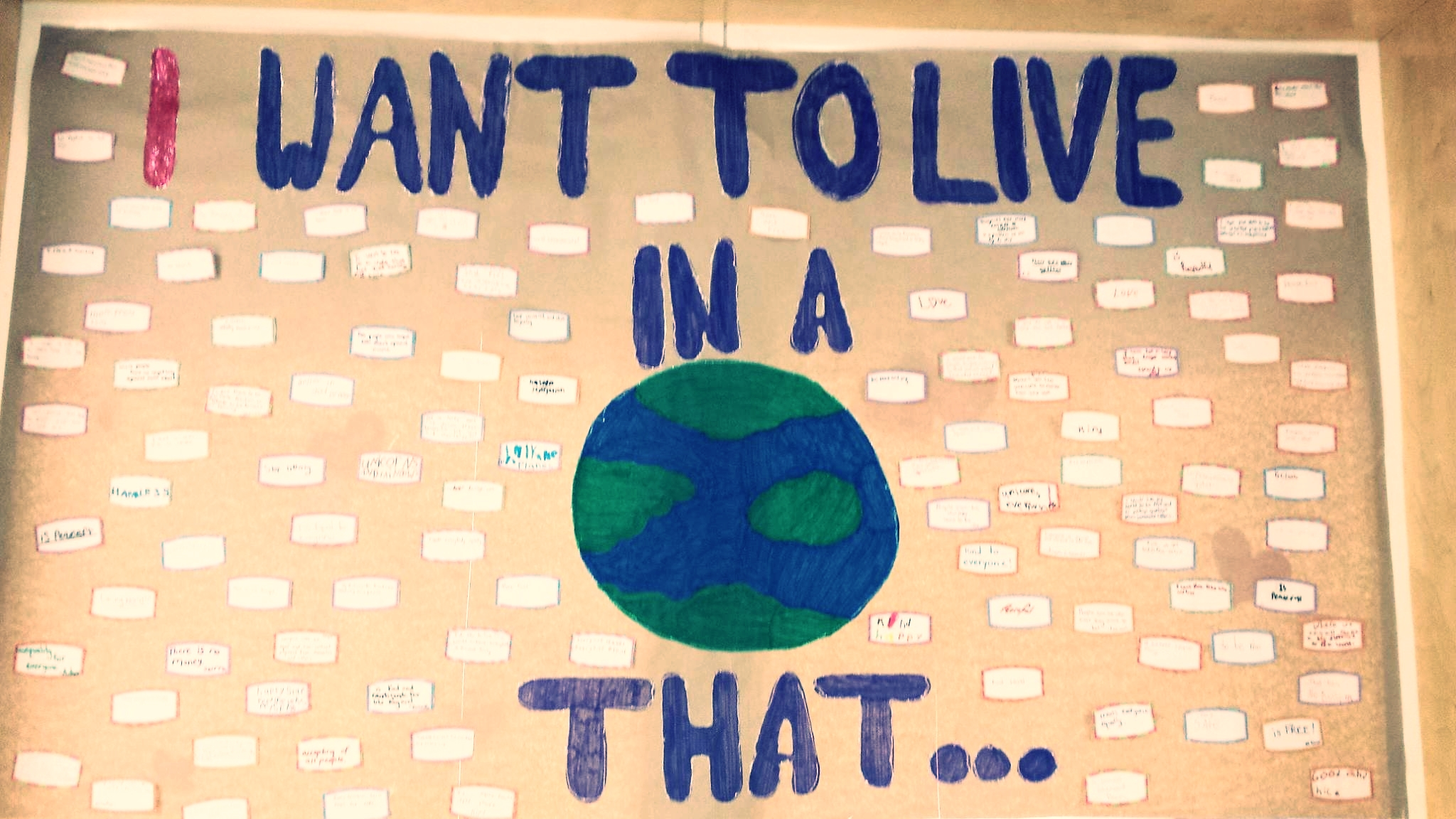 """The grade 6/7 class are making a conscious effort sharing their thoughts of what kind of world they'd like to live in, bringing awareness and sparking conversation. An interactive display board was created and the school community invited to share their thoughts by finishing the statement """"I want to live in a world that . . ."""" The focus being, what """"WE"""" can do to make this a reality.  The statement was also posted on Facebook inviting the community into the discussion.  Challenging people to think and share how they can make a positive difference in the world! Developing an understanding that dialogue is the first step to change and everyone's voice is important."""