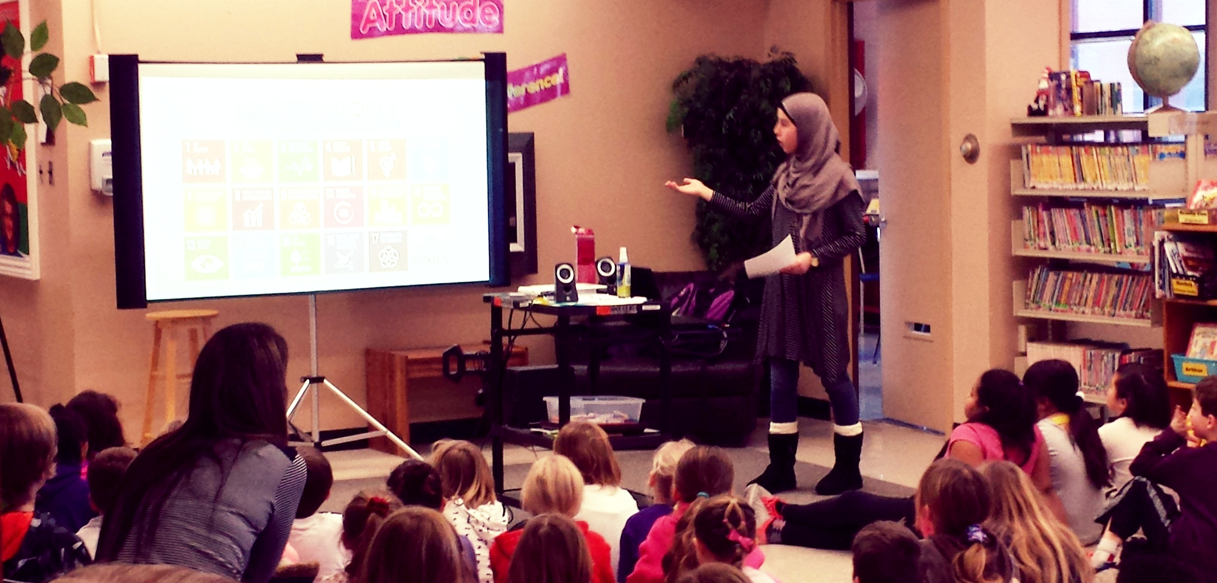 After having to cancel twice due to weather, Bessborough School was happy to welcome the Act4GlobalChange, New Brunswick Youth Ambassador, Hajar Abdesamie. Hajar came and gave a presentation to our grades K to 3 classes on the Act4GlobalChange initiative.  Hajar described for us the importance of global citizenship and gave examples of some activities other schools were doing to get involved. She also discussed climate change and it's connection to being a global citizen.