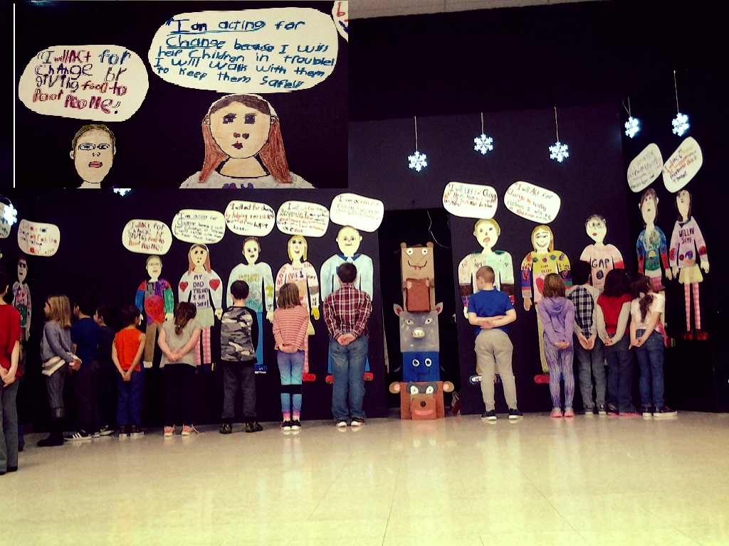"""Students created a life size representation of themselves. Prompted with """"I Will . . ."""" students considered how they would like to make a positive change. They then created a speech bubble for their finished, statement. The works are displayed on the back wall of the school's stage.  Our actions are inspired by our thoughts. If we can change the way we think, we can begin to change the actions we take."""