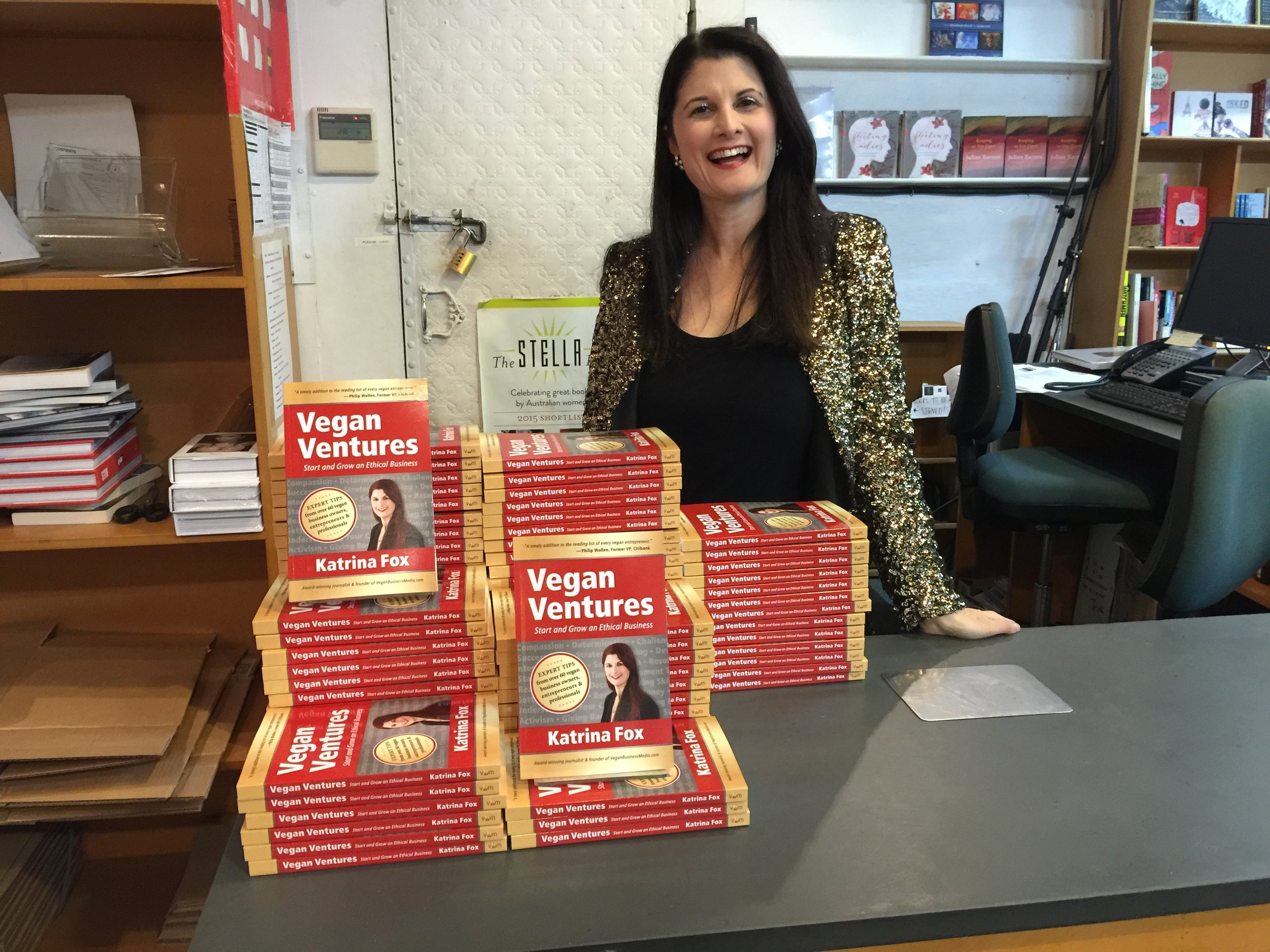 Katrina-with-books-at-counter-Sydney-launch.jpg