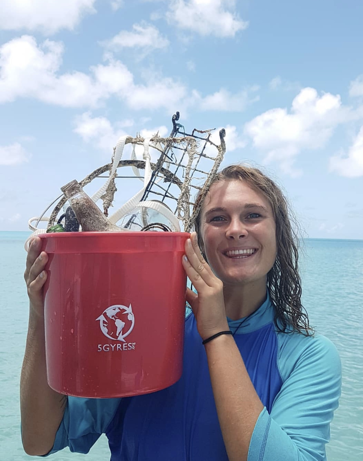Vevolution Festival 2016 volunteer Pyla Lara on a beach clean up in Bermuda