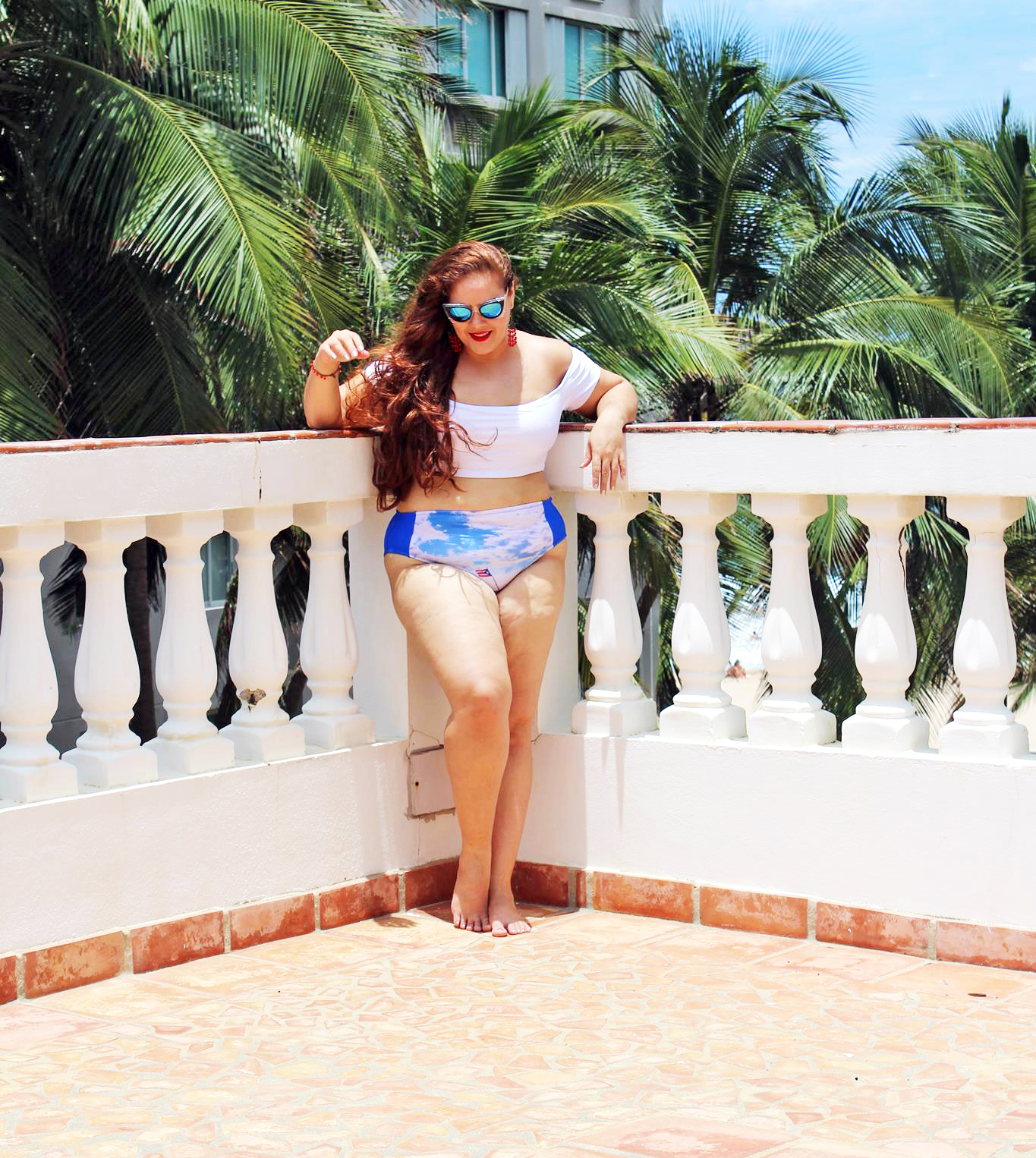 Swimsuit: Tommie Hernández Crash Boat Bikini. $95.00. Size XL. Made in Puerto Rico. Sunglasses:  DeLarge Shop