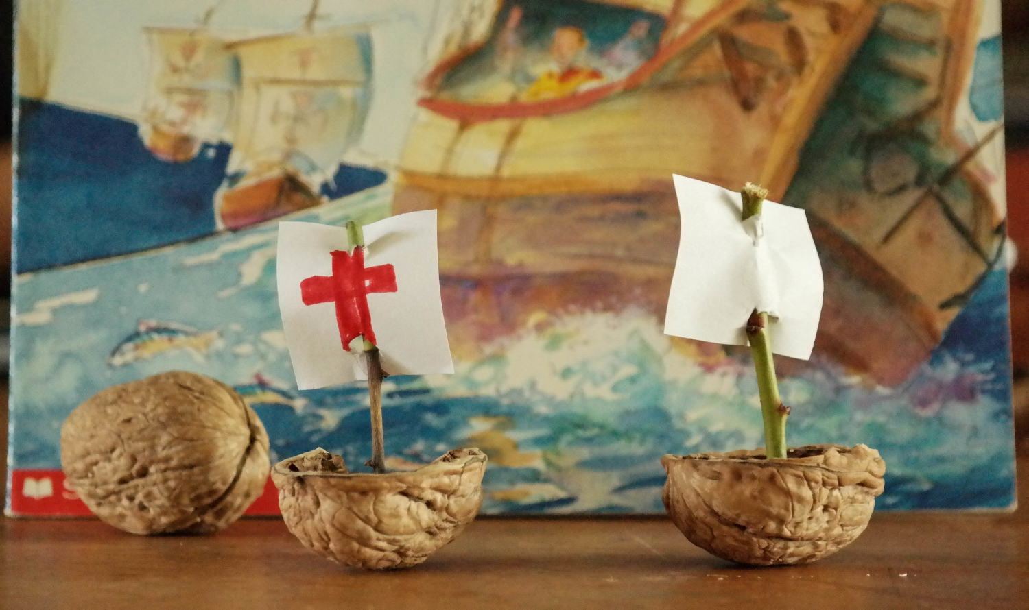 The walnut shell boats were created by carefully cracking a nut in half and scooping out the meats. We then put a small piece of clay in the empty shell, stuck a twig in the clay, and attached a paper flag to the twig. Easy and adorable.