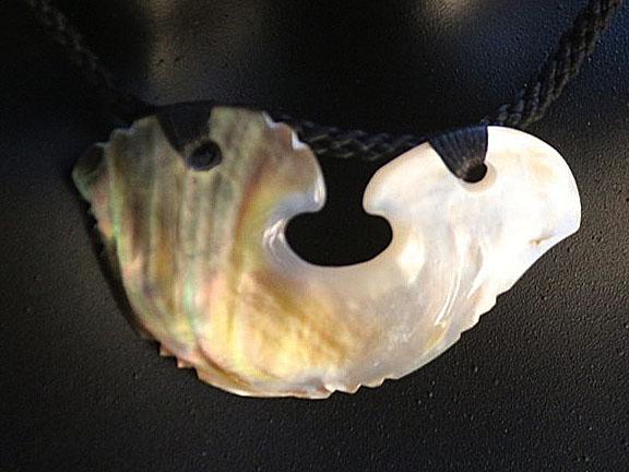 14. Hei matau (fishhook) silver lipped pearl shell