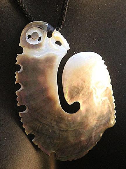 5. Hei matau (fishhook) silver lipped pearl shell