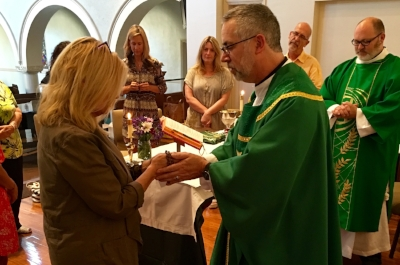 All are welcome to receive communion.