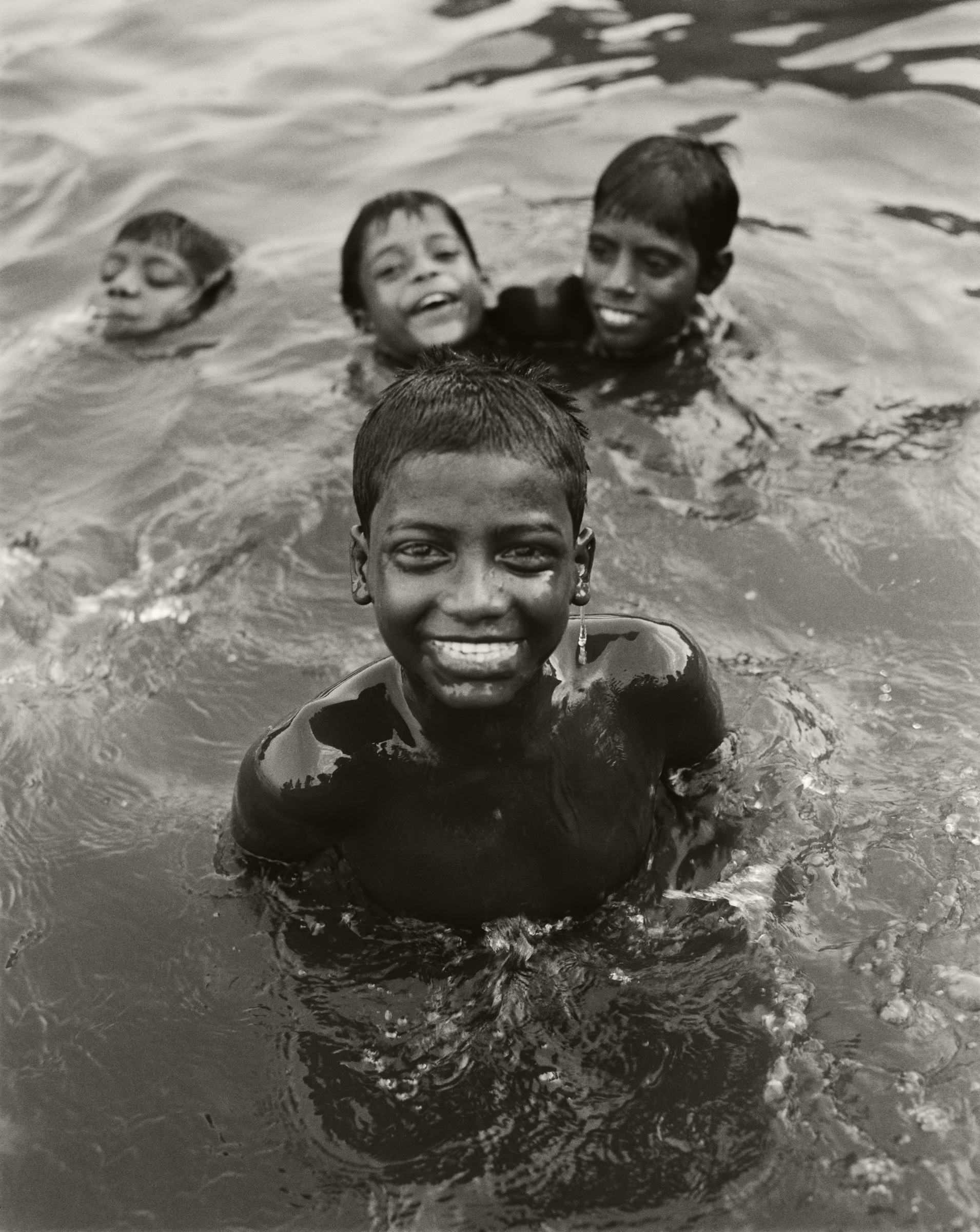 BOYS IN THE GANGES RIVER