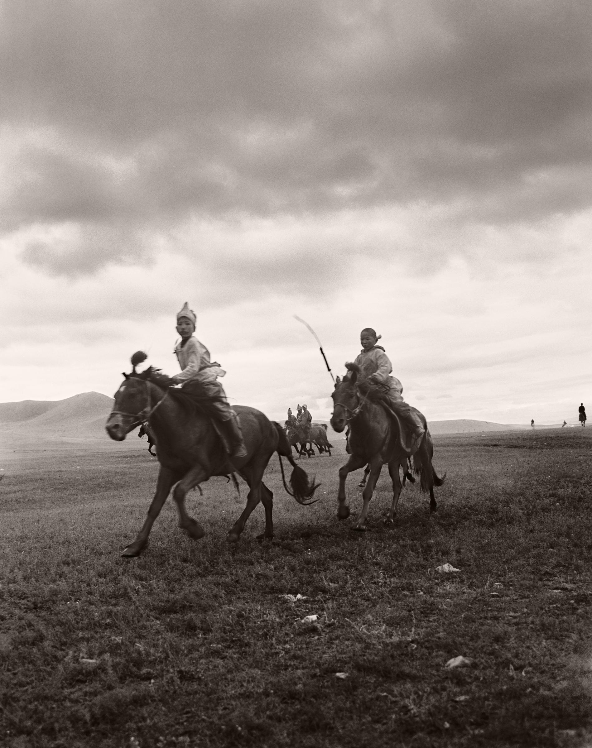 KIDS IN MONGOLIA ON HORSES