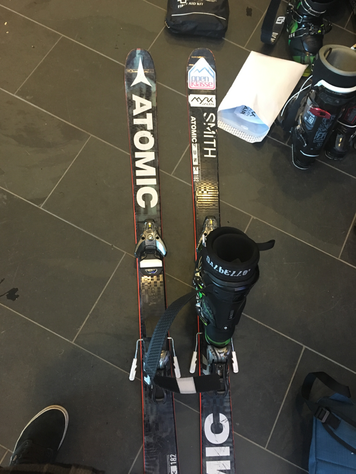 Setting up some of Klaus's skis for me to use