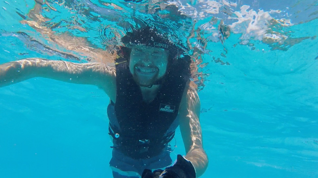 Still smiling, even underwater….
