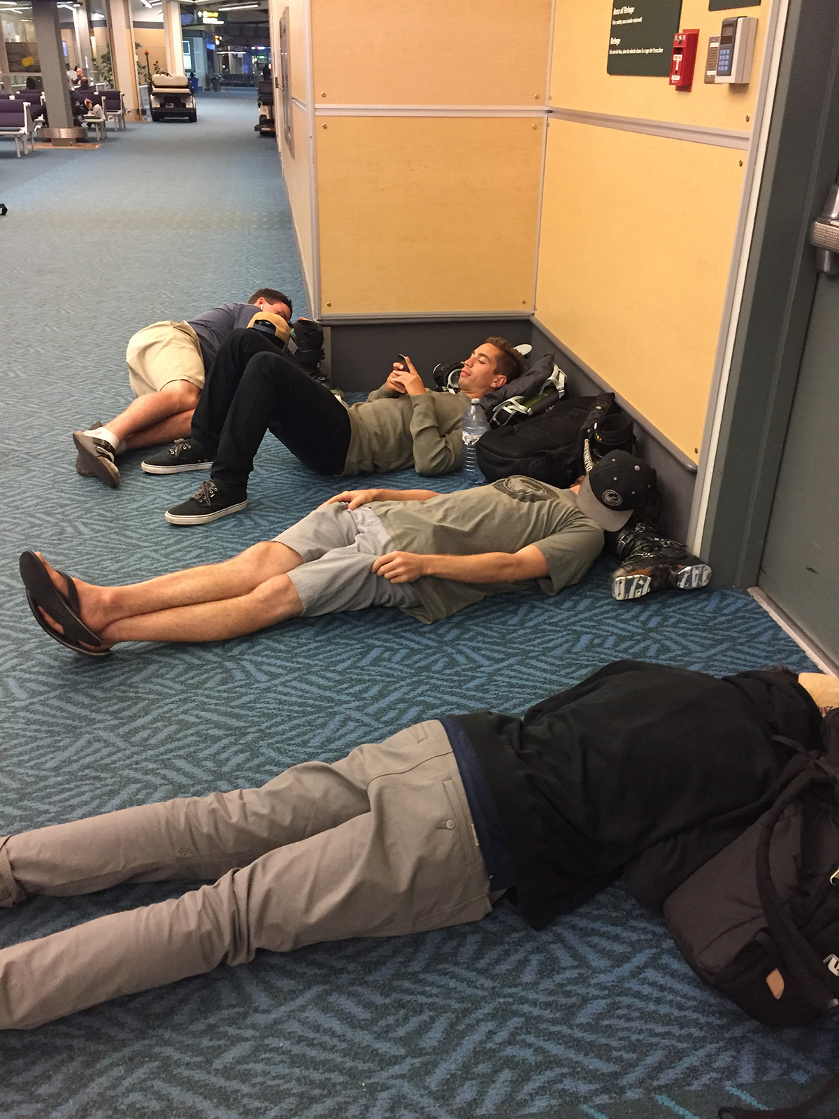 Teammates and I sleeping on the floor of the airport while waiting for our plane to be fixed…