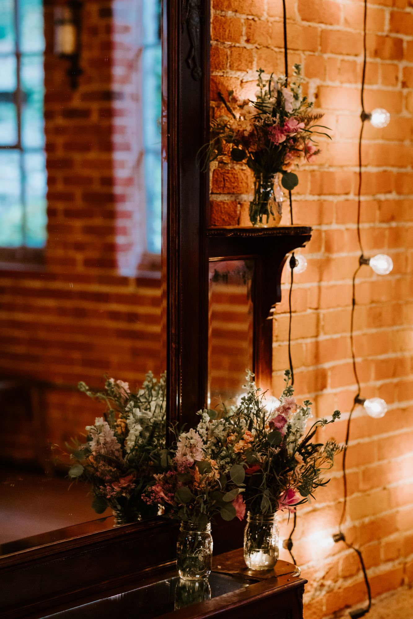 Rustic edison bulb wildflower ceremony set up | Carondelet House Wedding in Downtown Los Angeles | Los Angeles Wedding Photographer |Tida Svy Photography | www.tidasvy.com