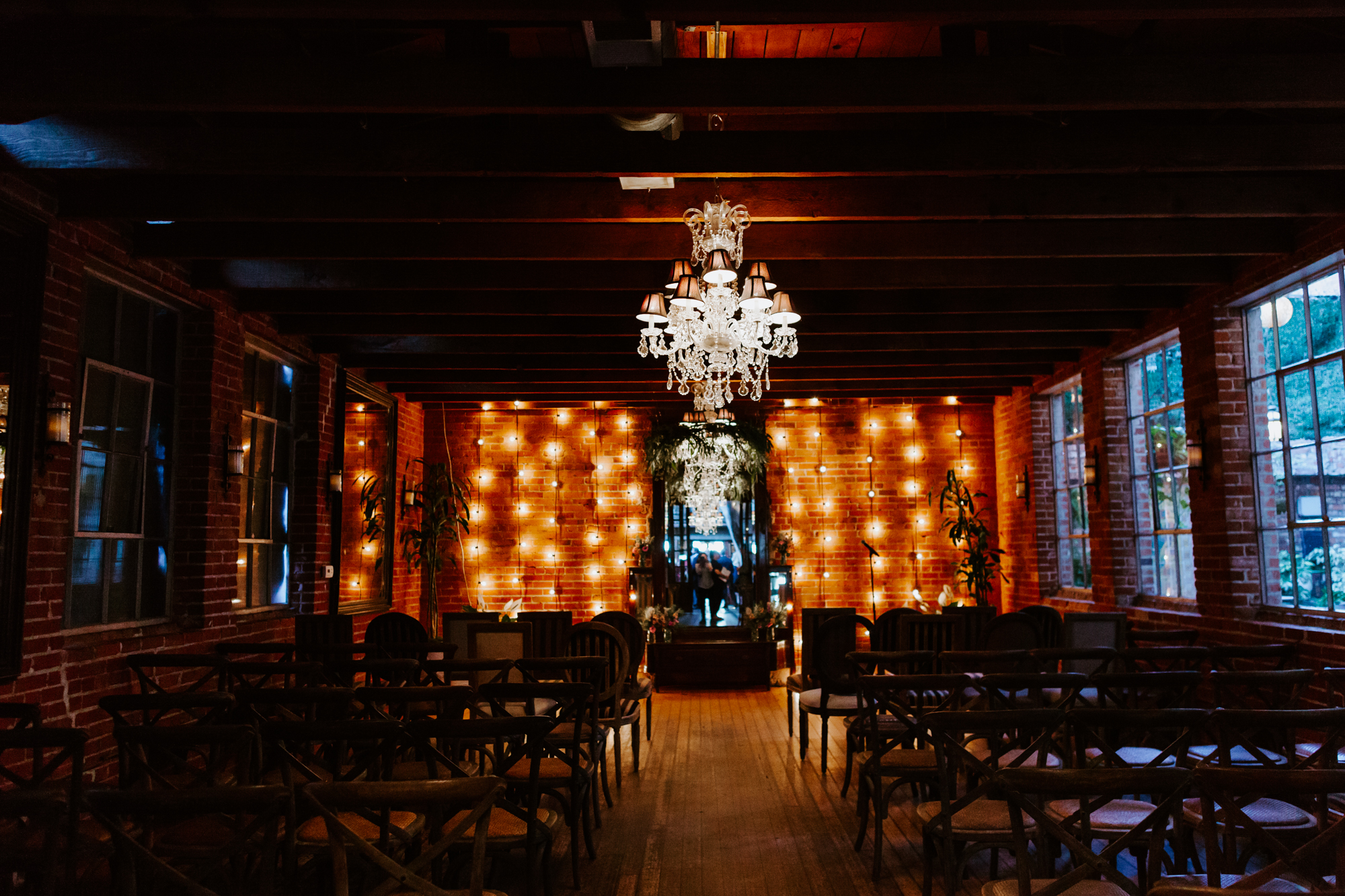 Rustic string light edison bulb wildflower ceremony set up | Carondelet House Wedding in Downtown Los Angeles | Los Angeles Wedding Photographer |Tida Svy Photography | www.tidasvy.com