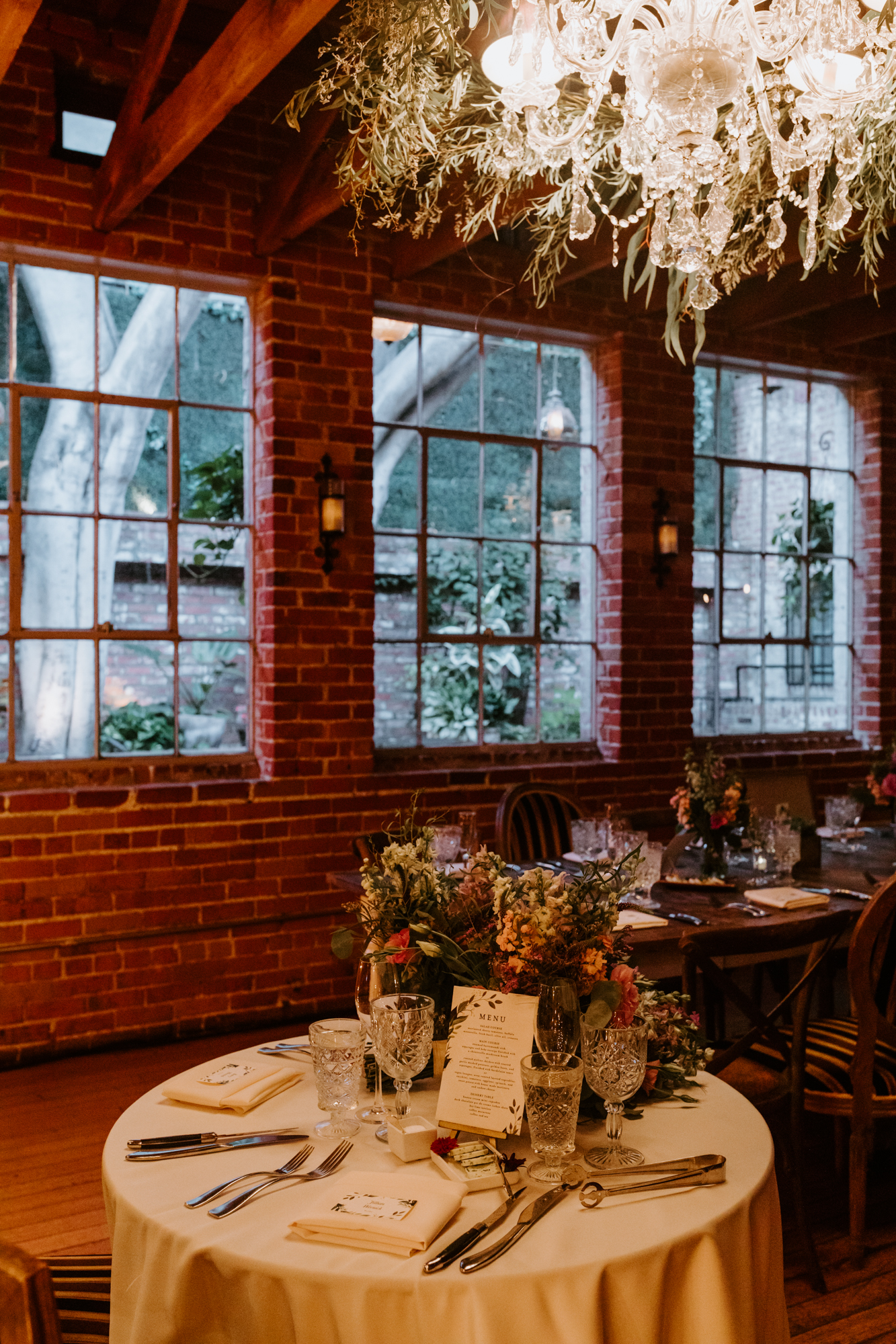 Romantic string light edison bulb rustic wildflower succulent reception inspiration | Carondelet House Wedding in Downtown Los Angeles | Tida Svy Photography | www.tidasvy.com