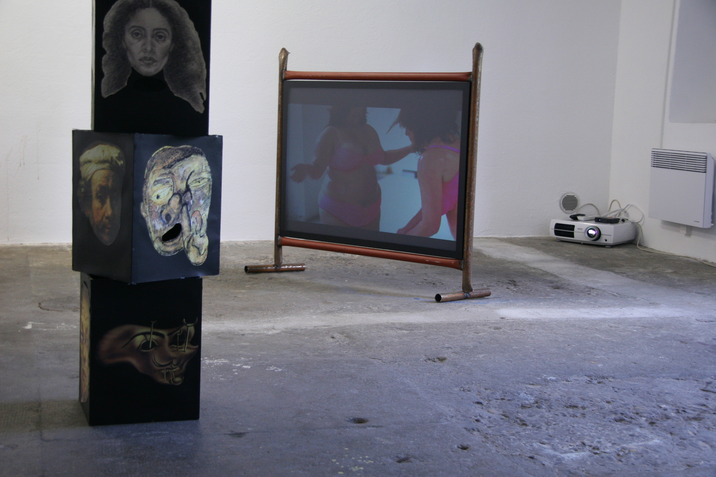 Present Continuous, 2016, Installation view, video projection on metal structure, looped video is 5 minutes and 32 seconds. Exhibition view No local, No global, Wallriss, Fribourg, 2013.