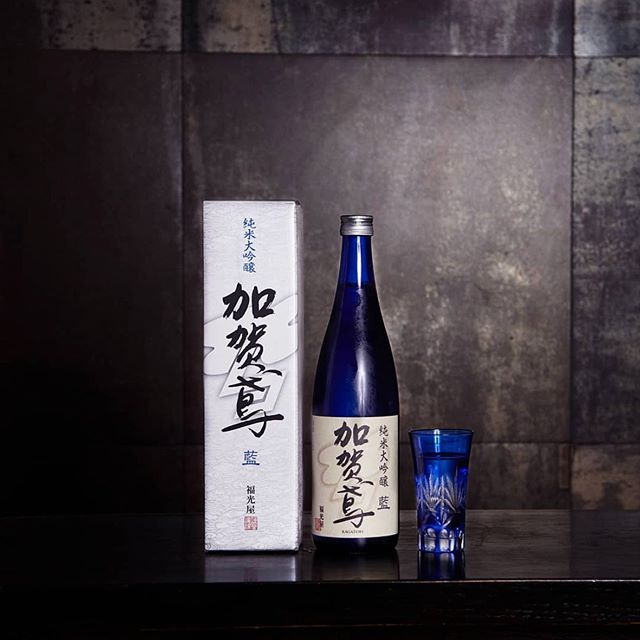 """The Kagatobi """"Ai"""" Junmai Daiginjo has a rich, yet overall light and clean flavor. It is bottled in a beautiful Indigo Blue bottle and is best served cold🍶⠀ @sakamainy⠀ #Kagatobi #Ai #Junmai #Daiginjo #Sake #JapaneseSake #SakeBottle #LES #SakaMai"""