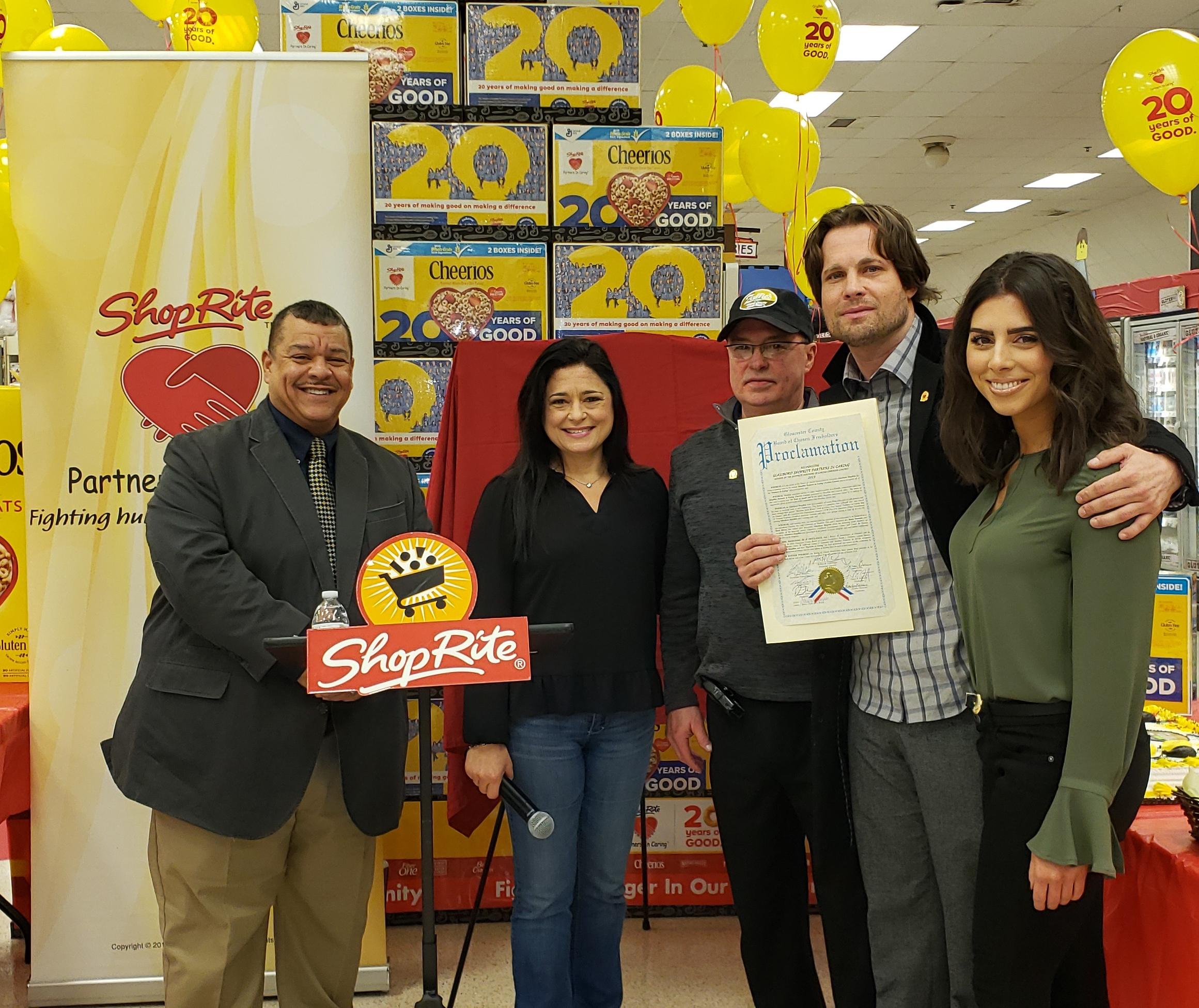 Mayor John E. Wallace III and Freeholder Heather Simmons award a proclamation