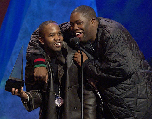 Big Boi with Killer Mike, accepting the award for  Favorite Hip-Hop/R&B Band, Duo, or Group on behalf of OutKast at the 30th Annual American Music Awards in 2003.