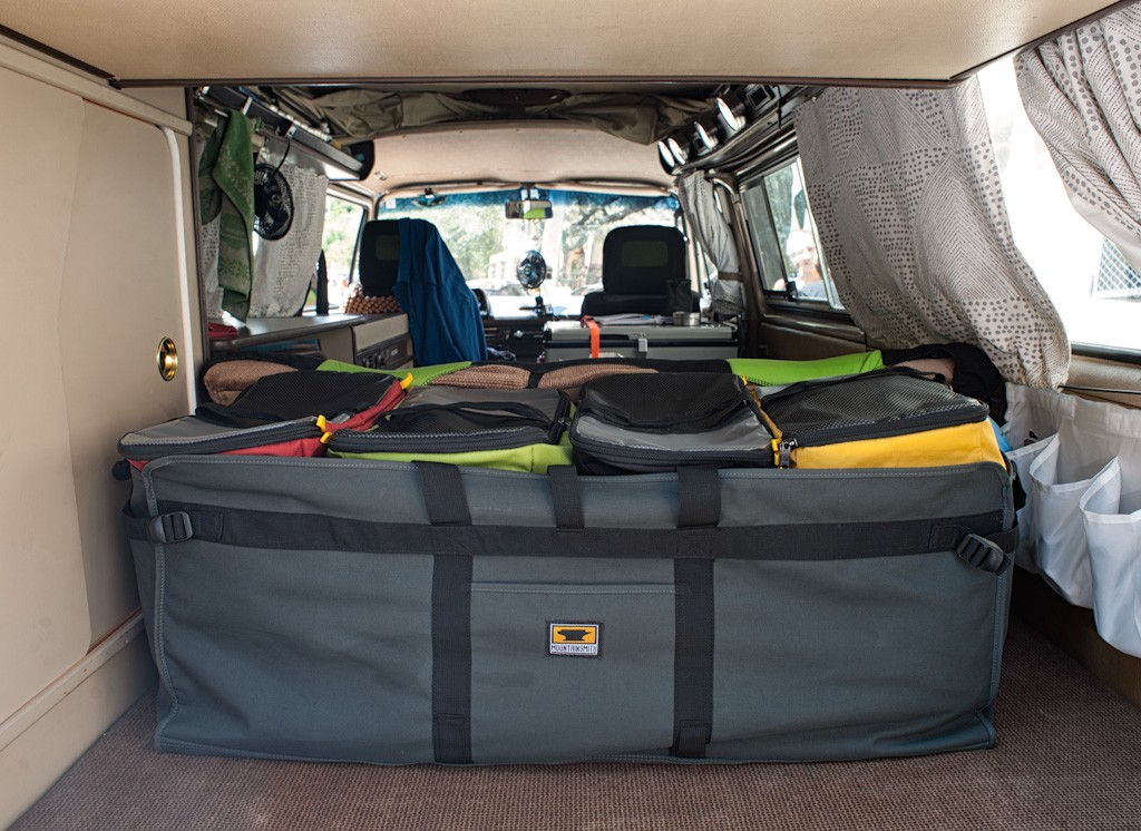 We each get one of these packing cubes for our clothes. My cube contains a few pairs of socks and underwear, seven shirts, including two long sleeve, two long pants, three shorts, and all my bandanas, of which the ocean has claimed three. We have winter clothes in a bag in the Thule box on top of Wesley. The carrying bag for the four cubes fits perfectly under the bench when it is folded out into a bed - thanks to R's careful measurements in her shopping.