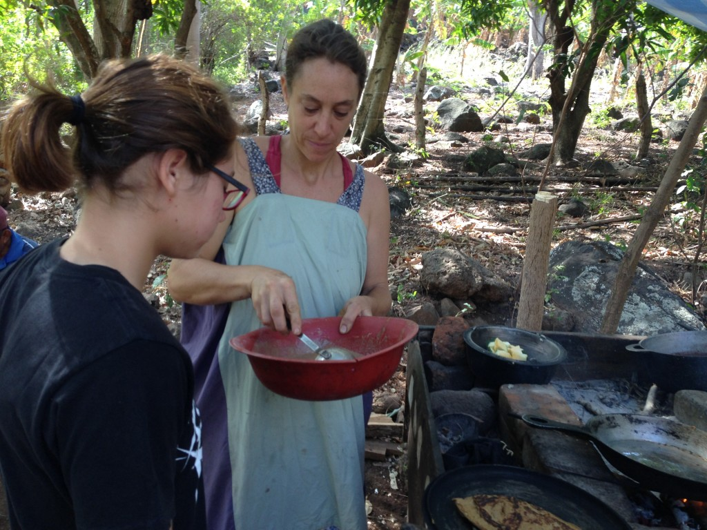Maria and Coconut making breakfast pancakes on the open fire.